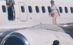 【驚愕】機内が暑くて我慢できなかった女性、非常扉を開けて翼の上で涼む